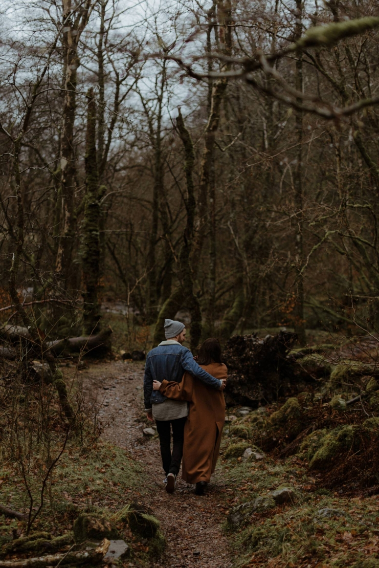 couple walking in scottish woods