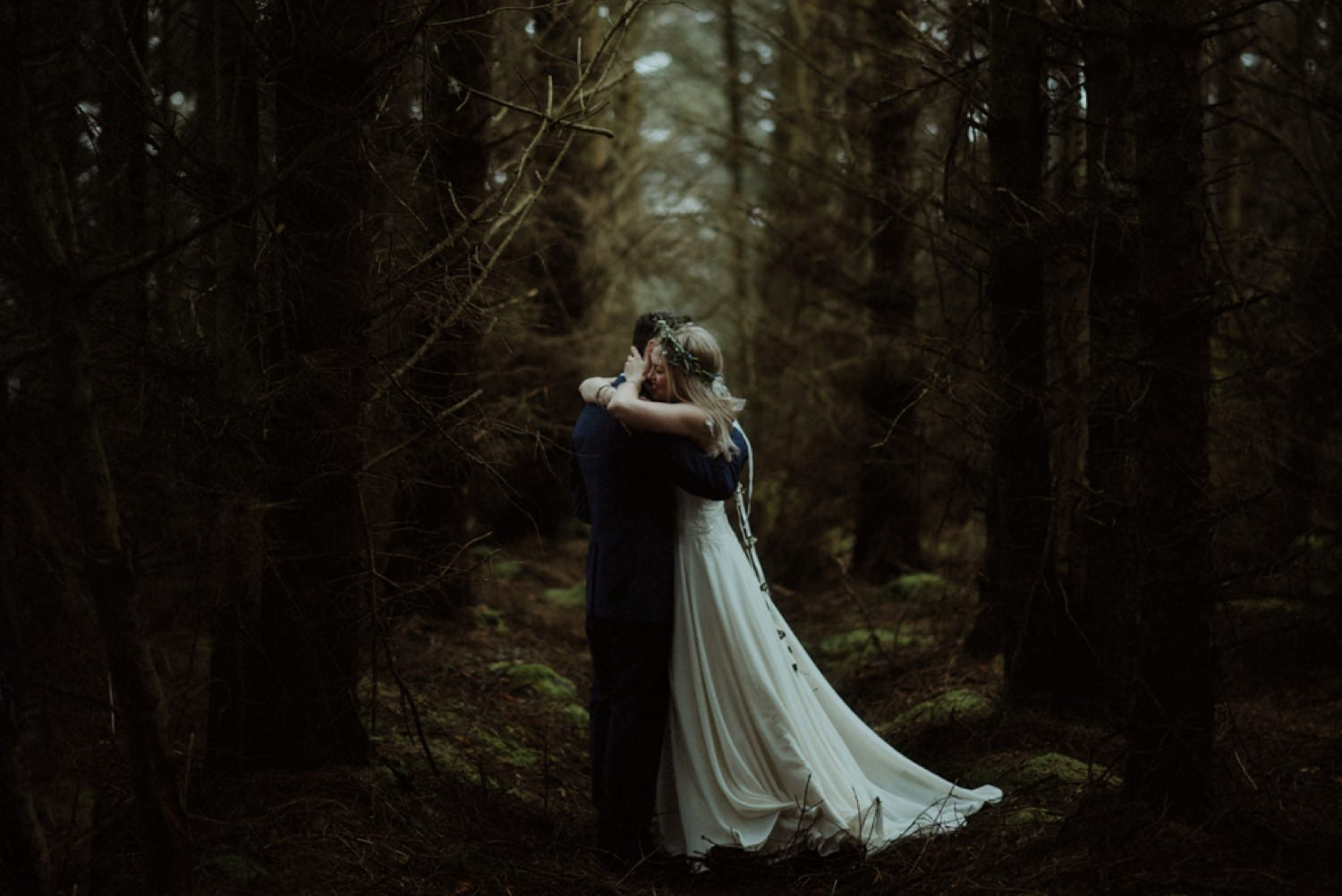 bride and groom in dark woods