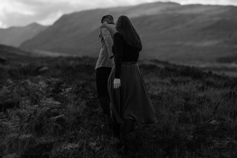 couple walking together in scottish highlands