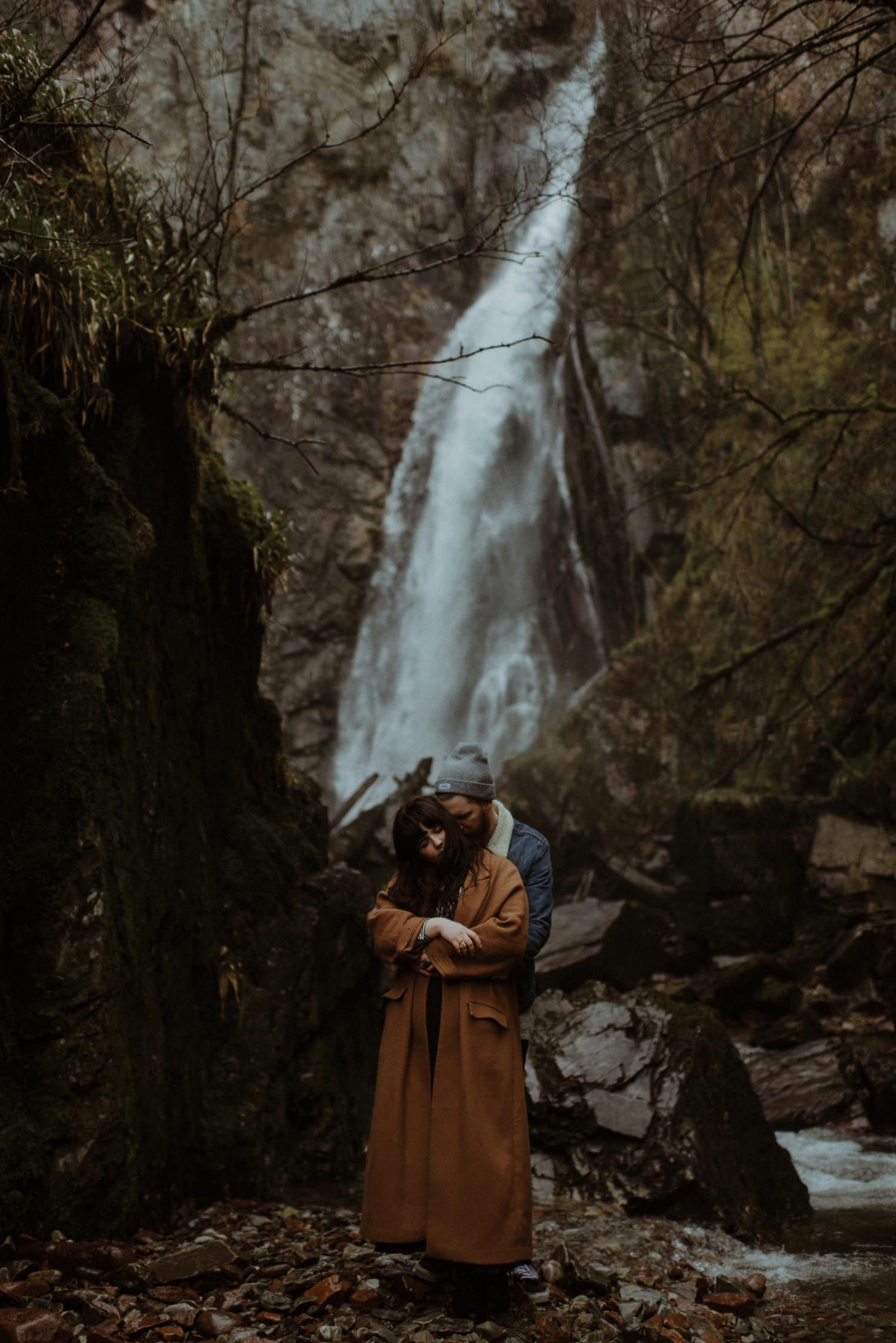 couple infront of waterfall scotland
