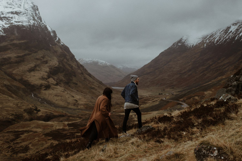 couple walking in glencoe mountains